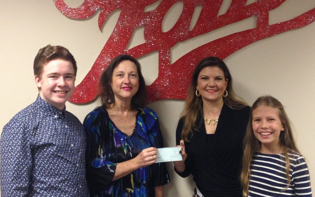 Academy of Children's Theatre (ACT) receives a Christmas donation from Cook Yancey